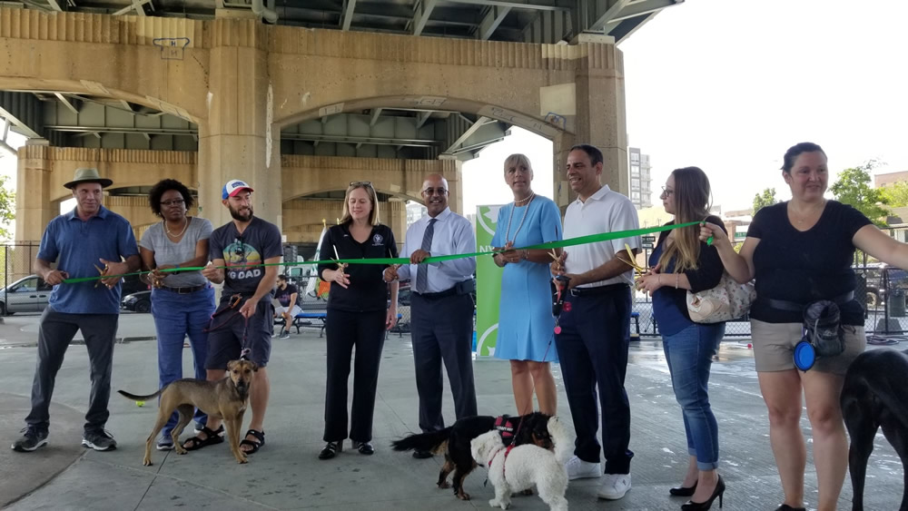 Ribbon cutting for new dog run and renovated basketball court under RFK Triborough Bridge